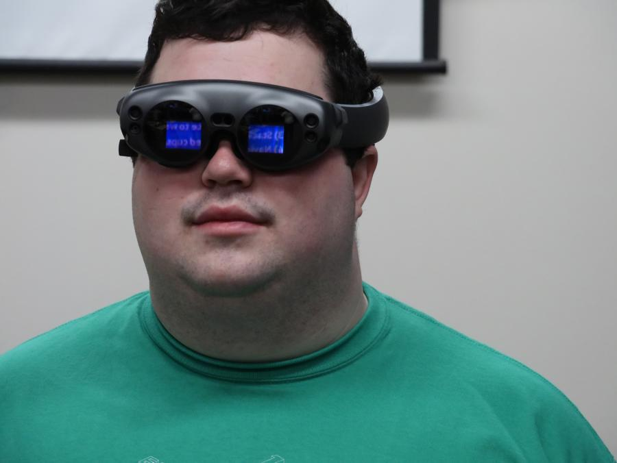 Tim Stern wears augmented reality goggles.