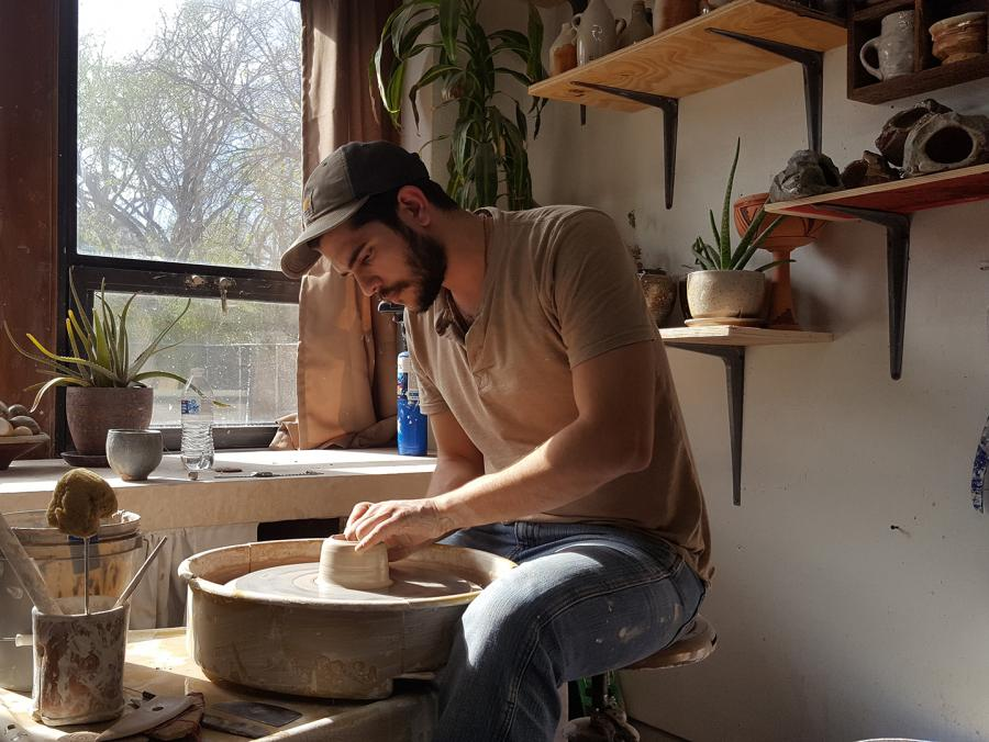 Horacio Casillas works on pottery