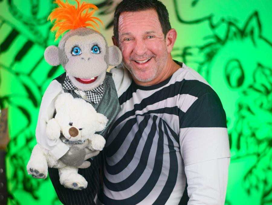 Dennis Lee and his puppet Nana Puddin'