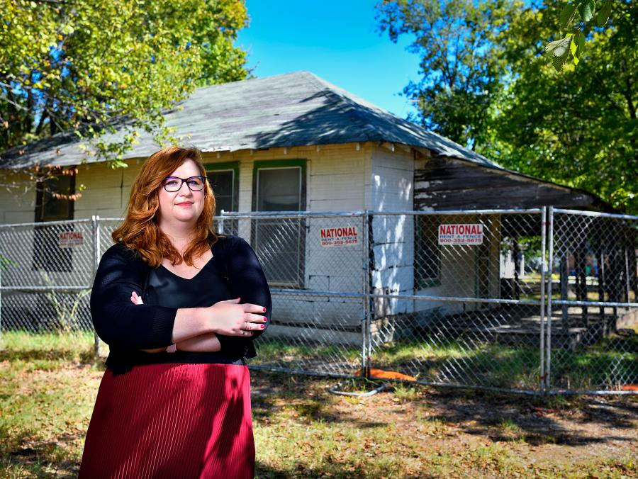 Micah Crittenden stands in front of the Burks Street house that used to be a one-room schoolhouse in Oakdale.