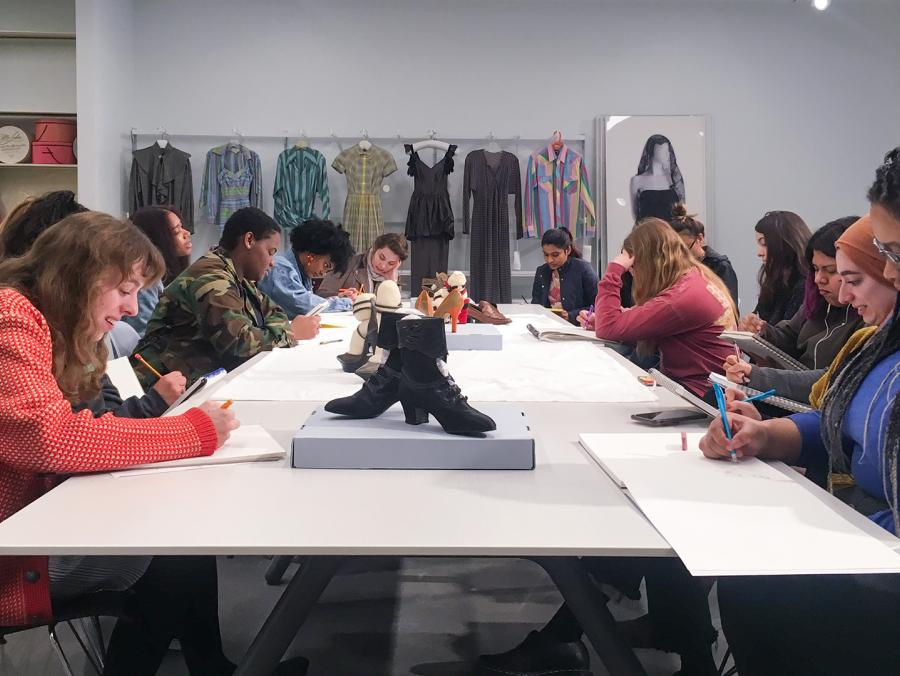 Fashion design students seated at a table