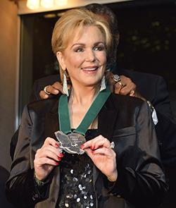 Phyllis George receiving Emerald Eagle honor