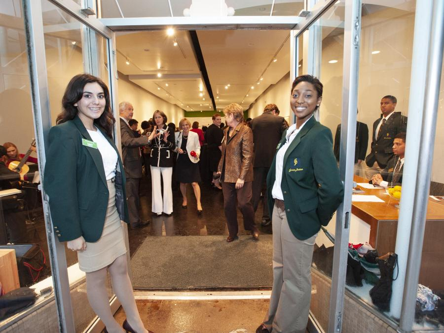 <p>Students opening doors to UNT on the Square</p>