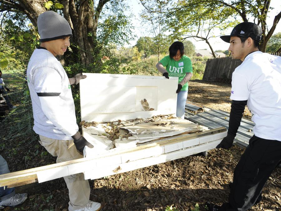 <p>Students working on Make a Difference Day</p>