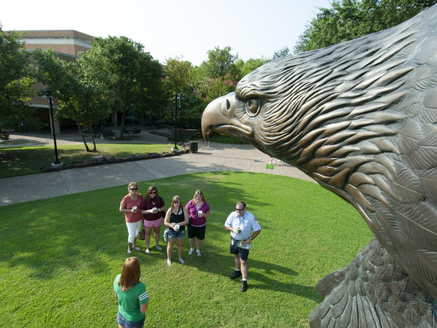 "Eagle sculpture ""In High Places"" overlooking students"
