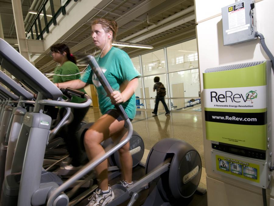 <p>Rec Center user on elliptical machine</p>