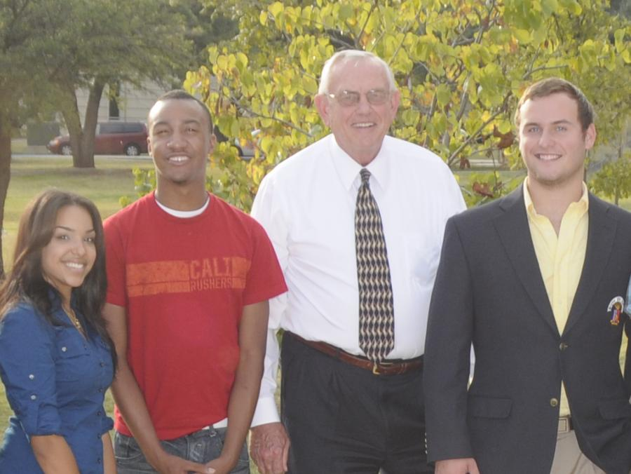 <p>President Lane Rawlins standing with students</p>