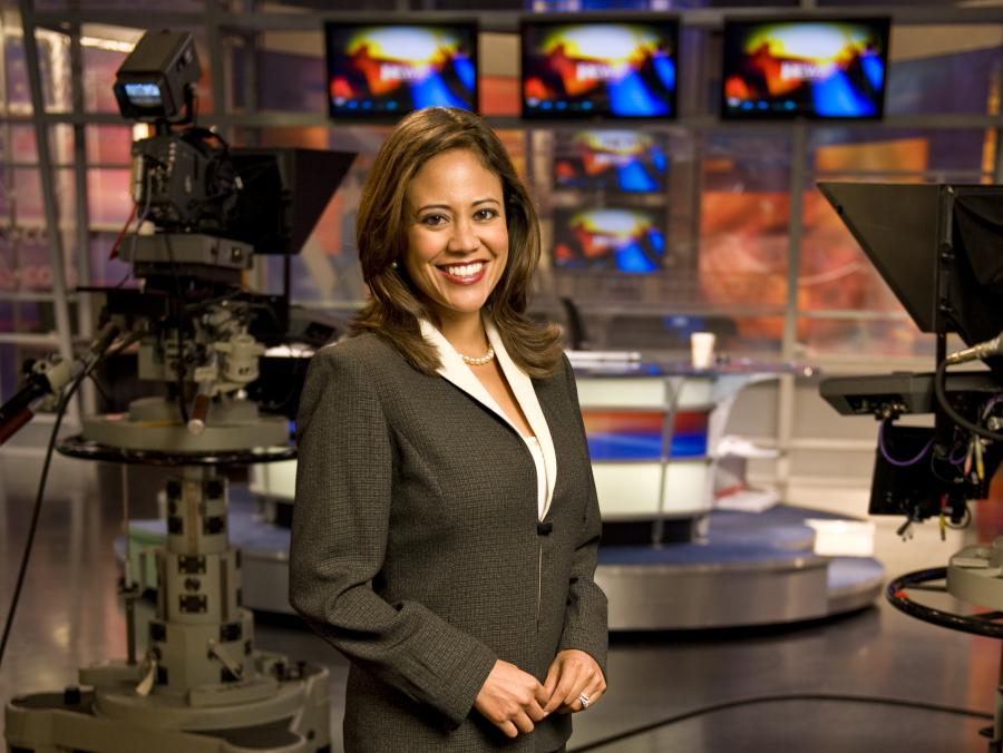 Cynthia Izaguirre standing in news studio