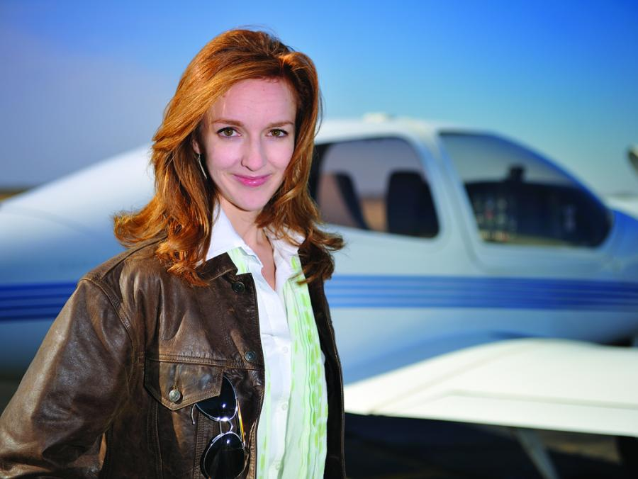 <p>Laura Rusnok standing in front of airplane</p>