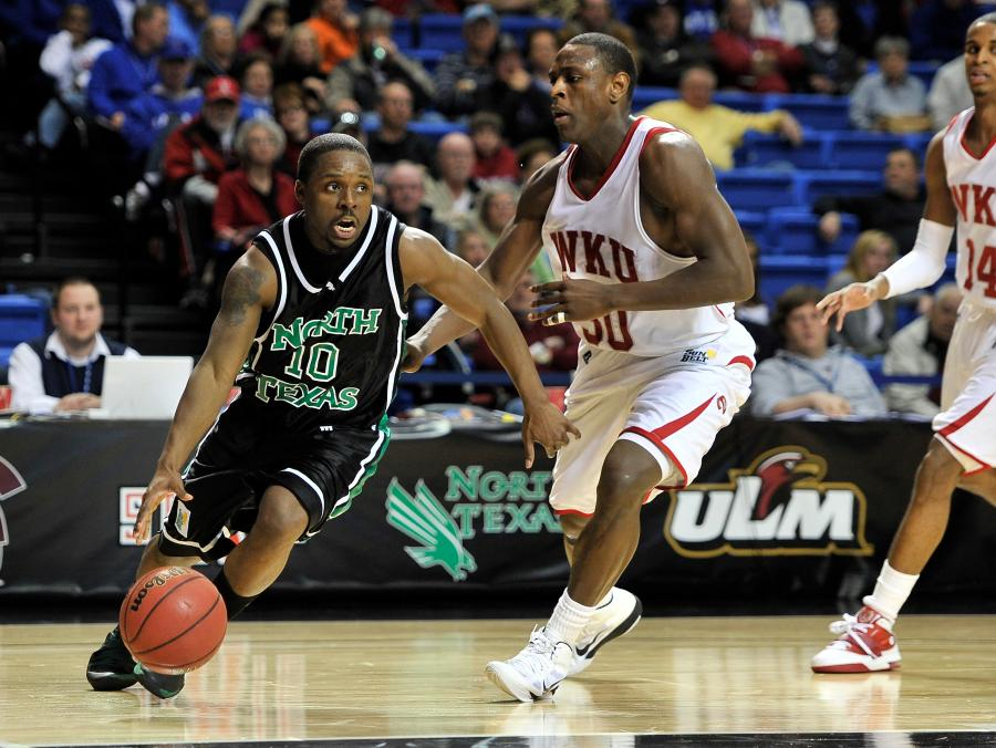 UNT's Josh White playing basketball against Western Kentucky