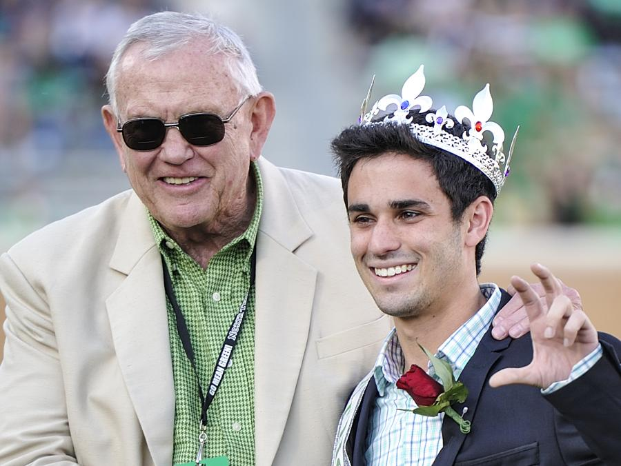 <p>President Lane Rawlins with Homecoming King</p>