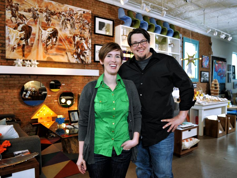<p>Erin and JP Hossley standing in store</p>