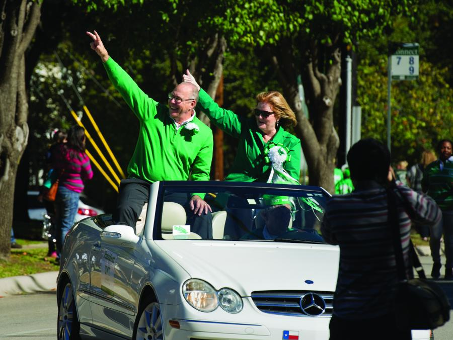 <p>President Neal Smatresk and wife Debbie Smatresk in car at Homecoming Parade</p>