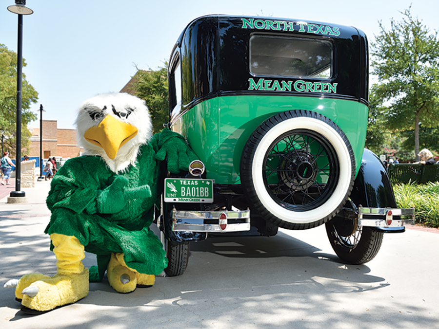 UNT mascot Scrappy poses with a UNT Model T car with UNT license plate