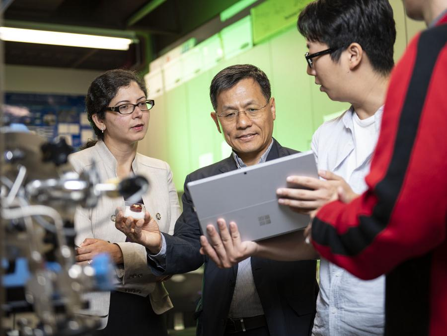 College of Engineering Associate Professor Gayatri Mehta (left) and Professor Wonbong Choi (middle) and discuss potential sensor materials with materials science and engineering graduate student Junyoung Kim (right).