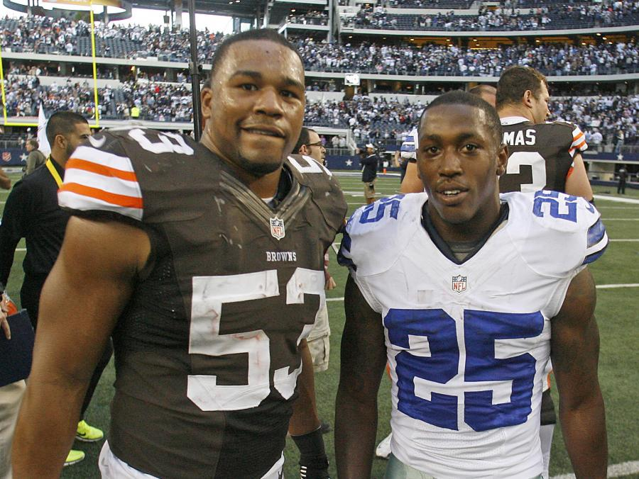 <p>Craig Robertson and Lance Dunbar at football game</p>