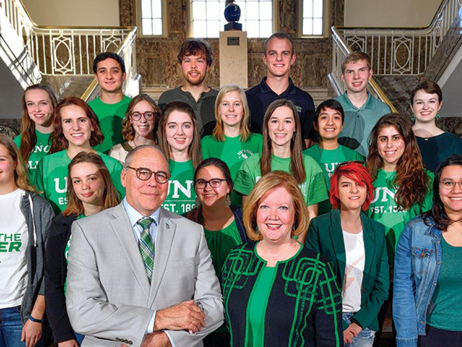 <p>President Neal Smatresk and his wife, Debbie, visit with National Merit Scholars. (Photo by Michael Clements)</p>