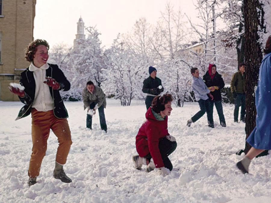 <p>1963 - UNT students having fun at a snowball fight on campus</p>