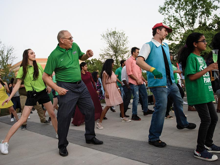 <p>UNT President Neal Smatesk particaptes in a dance at the 2018 Grad Block Party</p>