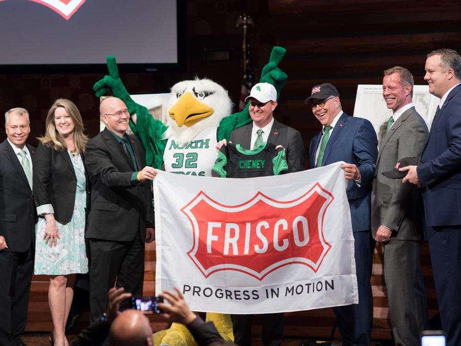 Pictured at left, from left to right: Frisco City Councilman Will Sowell, Frisco Mayor Pro Tem Shona Huffman, Frisco City Councilman Bill Woodard, Scrappy, Frisco Mayor Jeff Cheney, UNT President Neal Smatresk, Frisco Deputy Mayor Pro Tem John Keating and