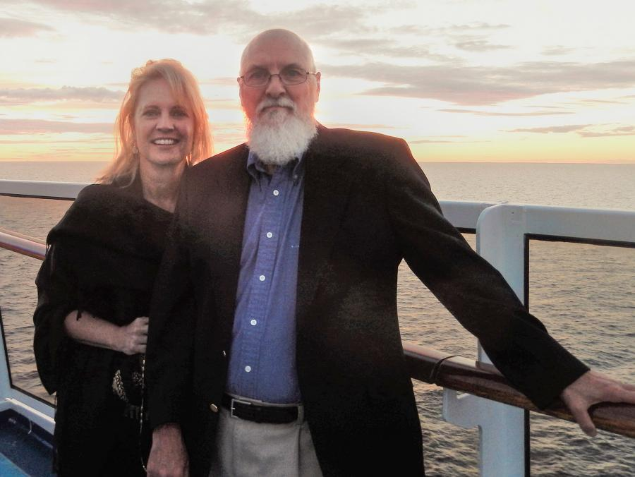 John  and Mary Alda by the railing on a cruise ship at sunset