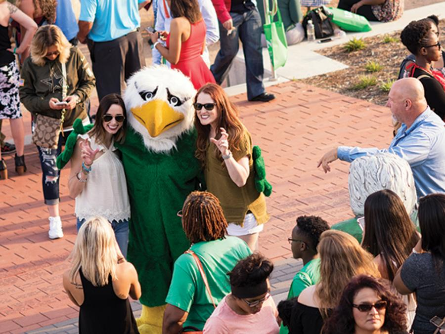 Students at an outdoor UNT Block Party
