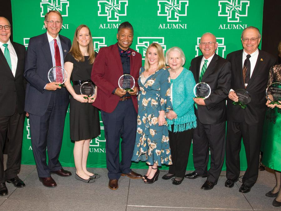 """Pictured at the Distinguished Alumni Achievement Awards Dinner are, from left, President Neal Smatresk, Don Millican ('74), Emily Mauzy ('06, '06 M.S.), Elliotte Dunlap ('97), Sarah Mickelson ('05), Mary Lu Waddell, Stephen 'Steve' F. Waddell ('75, '96 E"