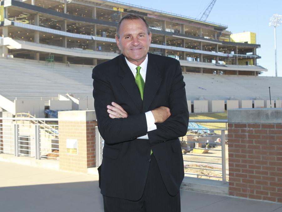 <p>Coach Dan McCarney at stadium</p>