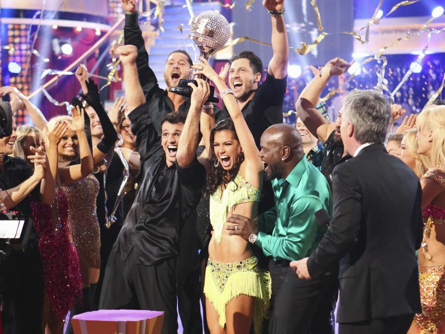 <p>Melissa Rycroft and others holding mirror ball trophy</p>