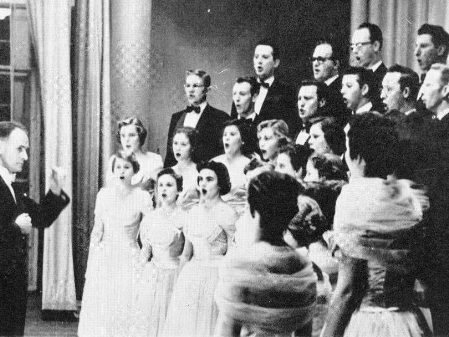<p>Frank McKinley directing A Capella Choir</p>