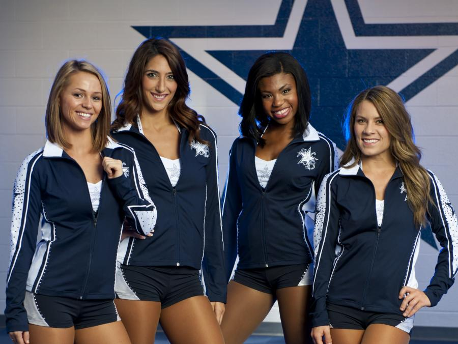 <p>Dallas Cowboys dancers standing</p>