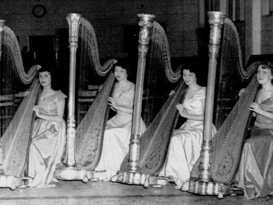 <p>Students playing harp</p>