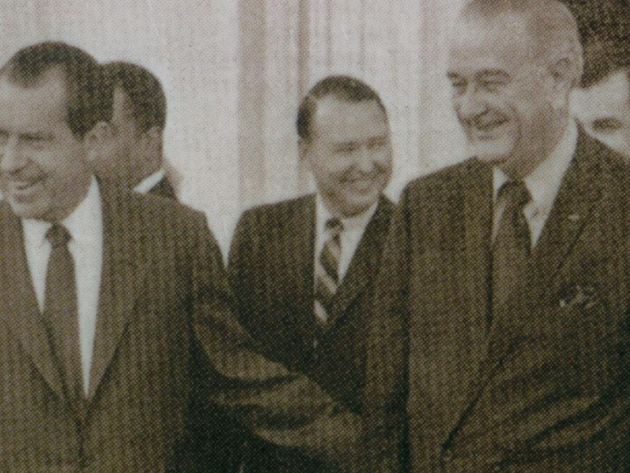 Mike Howard standing with Presidents Nixon and Johnson