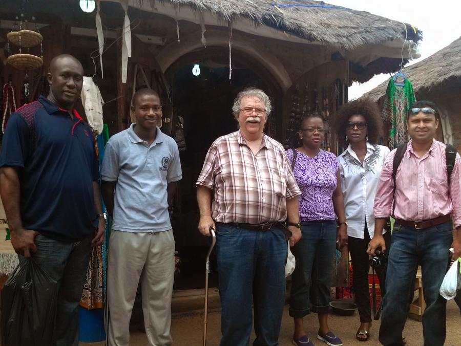 <p>UNT faculty and others standing in Nigerian market</p>