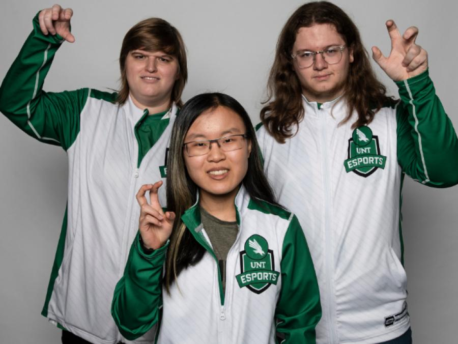 "Alexis ""Warped"" Peveler, Lauryn "" S4nguine"" Watanabe and Connor ""K3D"" Orr of the UNT Hearthstone esports team."