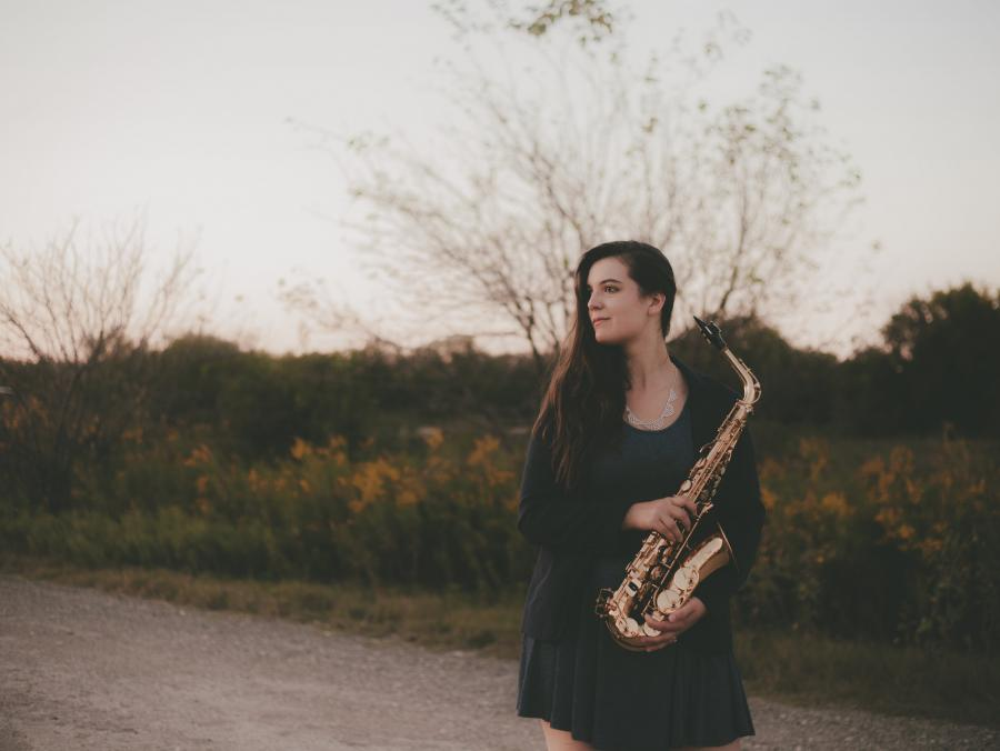 Jessica Rose Dodge with a saxophone