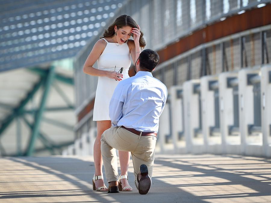 Chris Lee proposes to Karen Alday at the UNT pedestrian bridge.