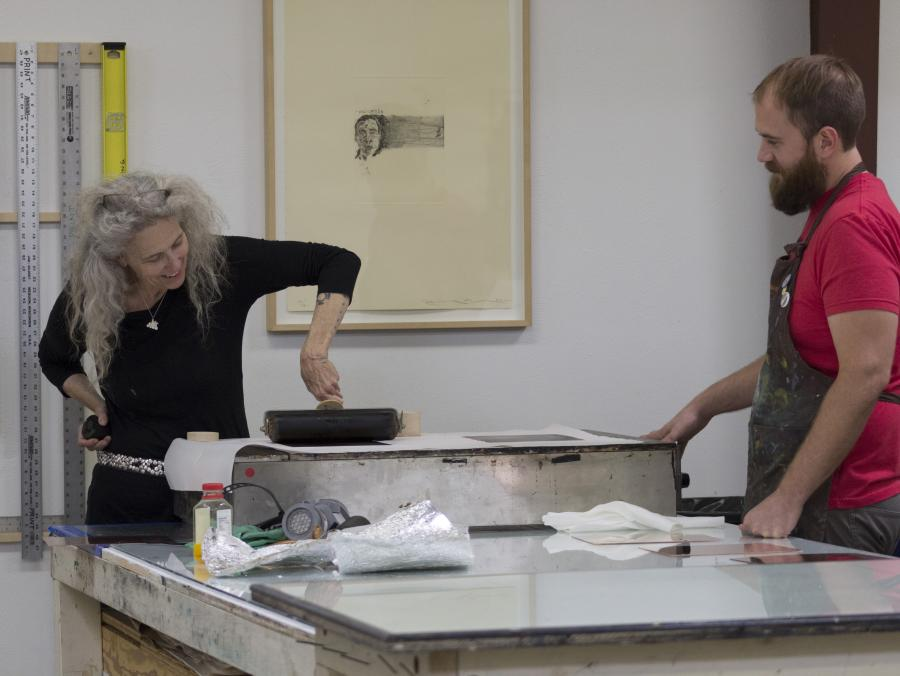 <p>Artist Kiki Smith working with student Preston Bradley</p>