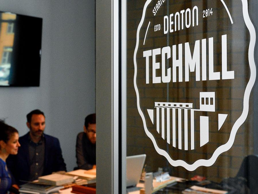 Denton Techmill door with a meeting in progress