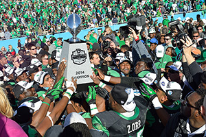 Mean Green football players celebrate at the Heart of Dallas Bowl (Photo by Michael Clements)