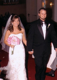 Ryan Tuomey ('08) sat behind NaShae Menefee ('08) wedding photo